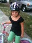 When I told Maria I was going to take her picture, she jumped off her bike and got in this pose!